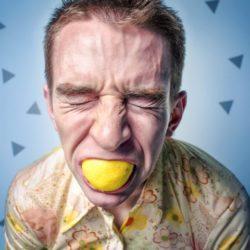 Man eat lemon